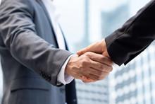 Businessmen Making Handshake I...