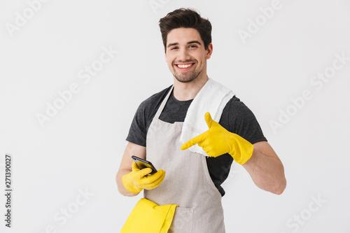 Cuadros en Lienzo Handsome brunette houseman wearing apron