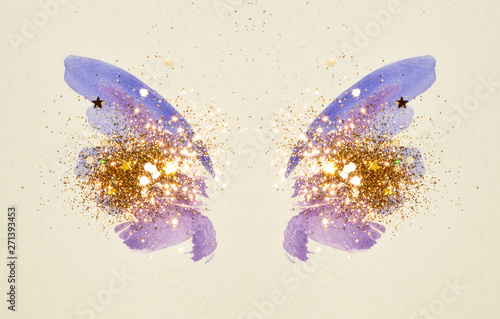 Photo sur Toile Papillons dans Grunge Glitter and glittering stars on abstract blue watercolor wings in vintage nostalgic colors.