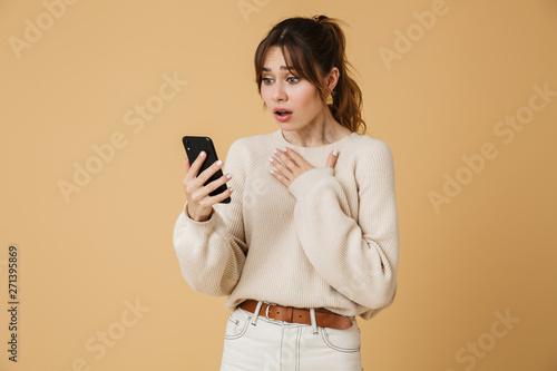 Beautiful young woman wearing sweater standing