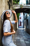 Portrait of a beautiful young happy woman. Street fashion photo.
