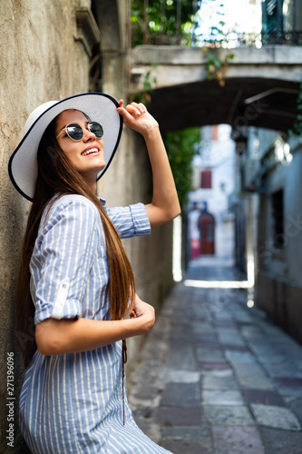 obraz lub plakat Portrait of a beautiful young happy woman. Street fashion photo.