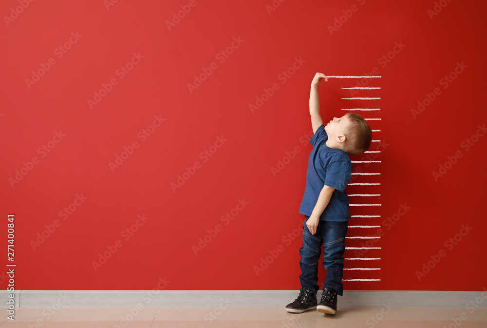 Fototapety, obrazy: Little boy measuring height near color wall