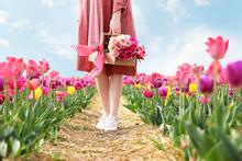 Beautiful Young Woman In Tulip...