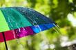 Leinwandbild Motiv Colorful umbrella outdoors on rainy day