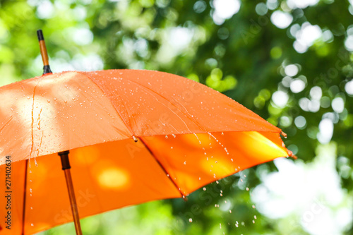 Foto Bright umbrella outdoors on rainy day