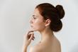 Leinwandbild Motiv Beauty portrait of an attractive young topless redhead woman