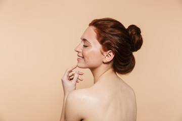 Beauty portrait of an attractive young topless redhead woman