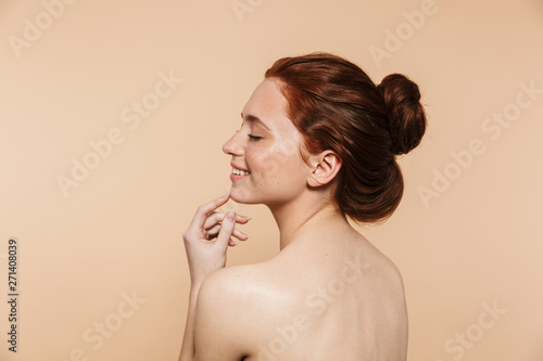 Obraz Beauty portrait of an attractive young topless redhead woman - fototapety do salonu