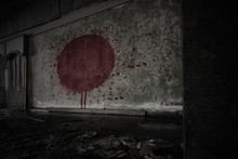 Painted Flag Of Japan On The Dirty Old Wall In An Abandoned Ruined House.