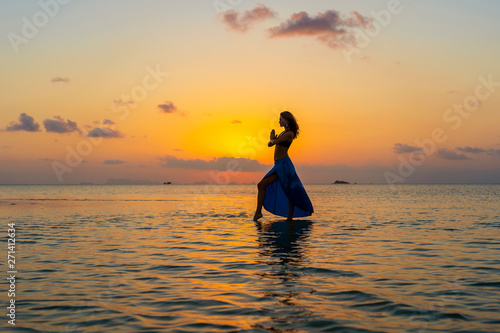 Montage in der Fensternische Melone Young beauty girl dancing at tropical beach on sea water at paradise island at sunset. Summer concept. Holiday travel.