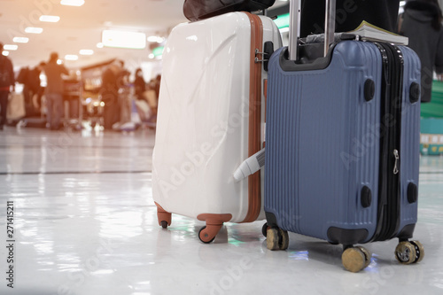 Tourist Travel with black large suitcases or baggage in lobby hotel waiting room or check in line at airport Canvas Print