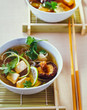 Chicken soup wiht coriander and shiitake mushrooms in a bowl