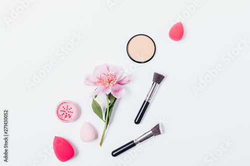 Fotomural  Flat lay abstract makeup background of pink peony