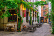 canvas print picture - Old street with tables of restaurant in Antwerpen, Belgium. Cozy cityscape in Antwerpen