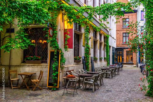 Staande foto Antwerpen Old street with tables of restaurant in Antwerpen, Belgium. Cozy cityscape in Antwerpen