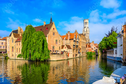 Wall Murals Bridges Classic view of the historic city center with canal in Brugge, West Flanders province, Belgium. Cityscape of Brugge.