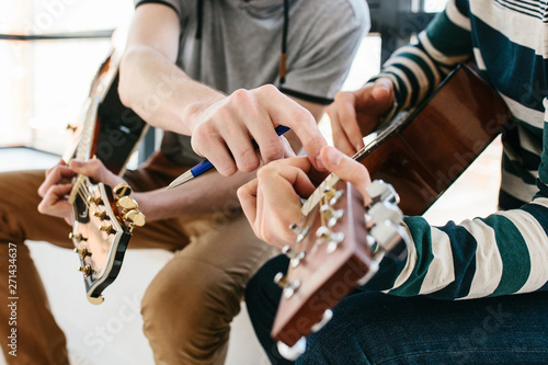 Learning to play the guitar. Extracurricular activities or tutoring or hobbies or creative activities. - 271434637