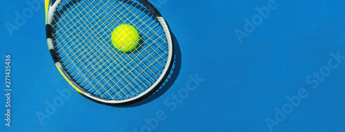 Fotografie, Obraz Summer sport concept with tennis ball and racket on blue hard tennis court