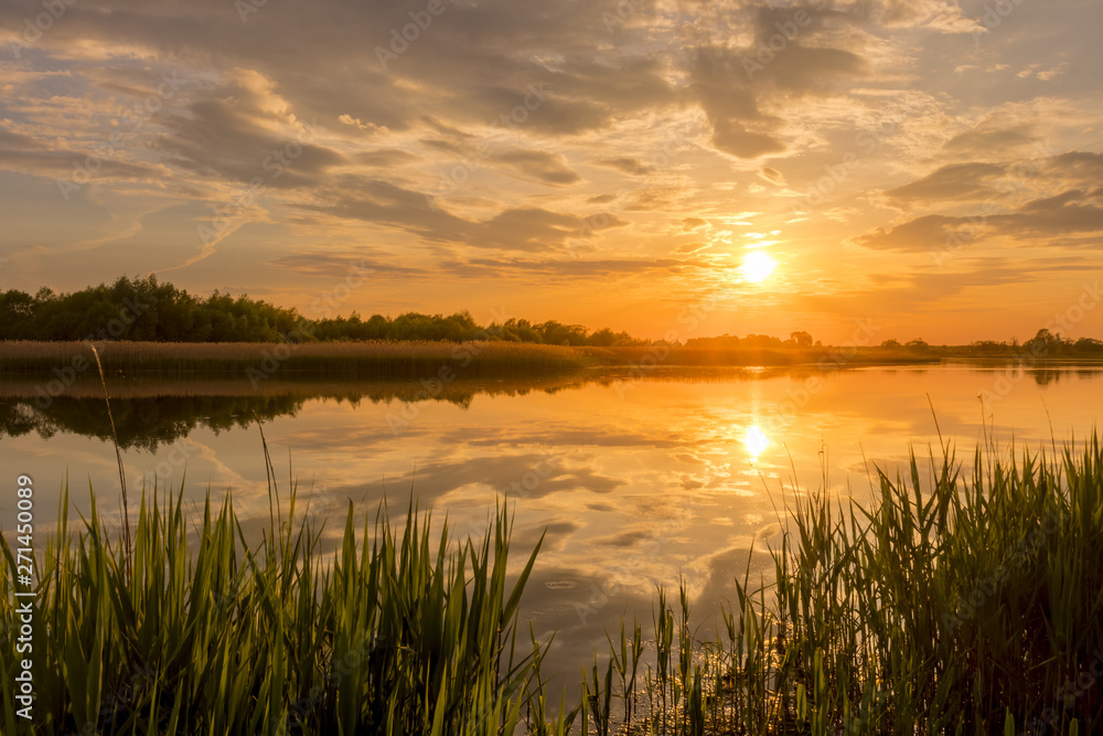 Fototapety, obrazy: Sunset above the pond or lake with cloudy sky at summer and water reflection.