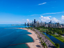 Chicago, IL/United States-May 30th 2019: Aerial Drone View Of The Chicago Downtown Skyline North Ave Beach During The Summertime Afternoon. Clear Skies And Clam Waters While Tourist Travel The City