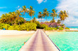 Beautiful tropical Maldives resort hotel and island with beach and sea