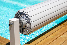 Pool Shutter To Conserve Heat And Protect From Accidental Falls