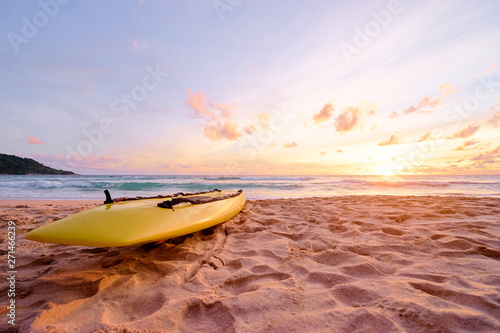 Foto auf Leinwand Lachs Beautiful landscape. Sunset on the sea beach with lifeguard surf board on sand.