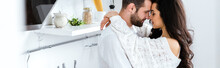 Lovely Gently Couple Embracing With Closed Eyes At Kitchen, Panoramic Shot