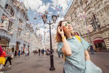 Happy Asian Woman Traveler Posing At The Arbat Street In Moscow
