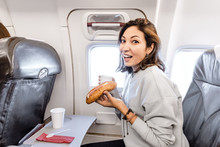 Happy Asian Woman Eating Sandw...