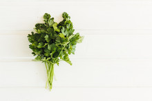 Fresh Parsley On Wooden Background. Organic Italian Parsley Closeup On Rustic Board, Vegetarian Food Overhead. Bunch Of Raw Cilantro Herb Flat Lay, Flat Lay, Place For Design And Text.