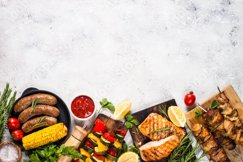 Barbeque dish - Grilled meat, fish, sausages and vegetables. Canvas Print