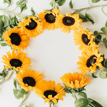 Wreath Frame Made Of Sunflowers With Copy Space On White Background. Flat Lay, Top View Summer Floral Mock Up Template.