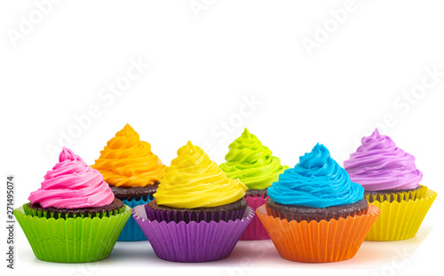 Rainbow Colored Frosted Chocolate Cupcakes on a White Background Canvas Print
