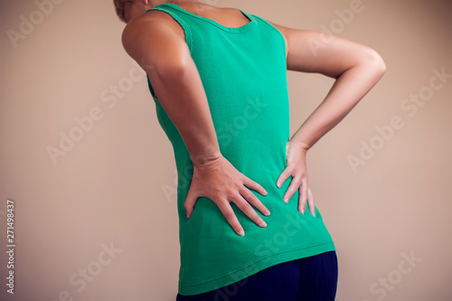 Cuadros en Lienzo  Woman feels strong pain in back isolated