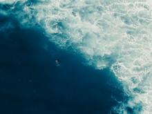 Aerial View Of Man Paddling In Sea