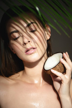 Beautiful Woman With Coconut And Shadows Of Palm Leaf On Her Face