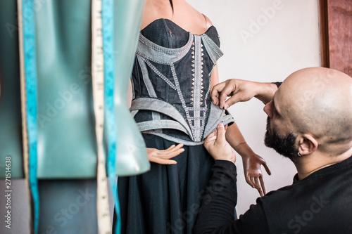 Fotografija Close up photo of fashion designer working on his new creation.