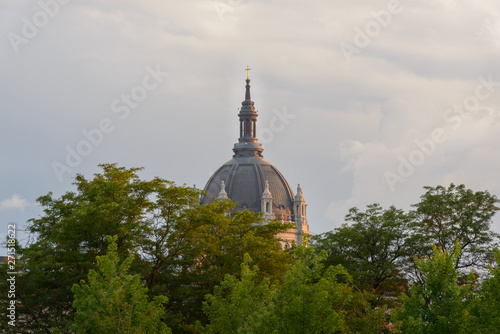 shiny cross on church dome in cloudy sky