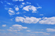Sunny day with floating white cloud. Background in the form of a cloudy sky. Clouds against a clear autumn sky.