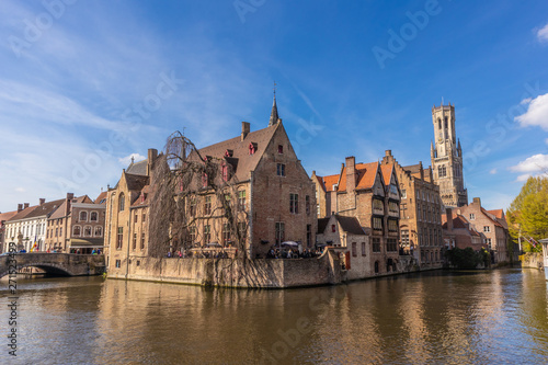 Wall Murals Bridges Bruges, Belgium - APRIL 05, 2019: Historic medieval buildings and canal in the old town of Bruges