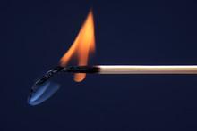 Burning And Smoking Wooden Match On Dark Background.