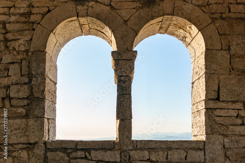 Two windows in an old tower or fortress, view from the inside. Canvas-taulu