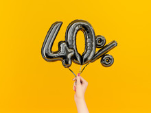 Forty Percent Symbol Discount. 40 % Sale Banner Black Flying Foil Balloons On Yellow. 3d Rendering.