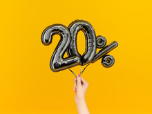 Twenty Percent Symbol Discount. 20 % Sale Banner Black Flying Foil Balloons On Yellow. 3d Rendering.