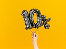 Ten Percent Symbol Discount. 10 % Sale Banner Black Flying Foil Balloons On Yellow. 3d Rendering.