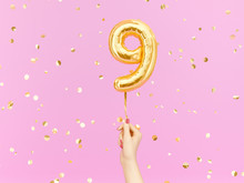 Nine Year Birthday. Female Hand Holding Number 9 Foil Balloon. Nine-year Anniversary Background. 3d Rendering