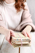 Young Woman Holding Old Letters.