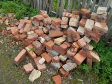 A Pile Of Broken Orange Bricks In Disarray